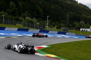 Lando Norris, McLaren MCL35, leads Daniil Kvyat, AlphaTauri AT01