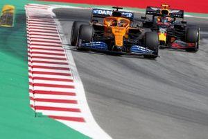 Carlos Sainz Jr., McLaren MCL35, leads Alex Albon, Red Bull Racing RB16