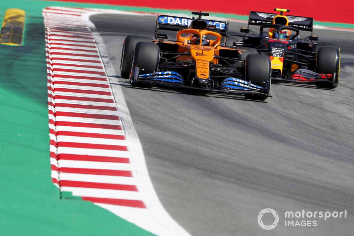 Carlos Sainz Jr., McLaren MCL35, leads Alex Albon, Red Bull Racing RB16