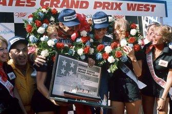Podium: race winner Clay Regazzoni, Ferrari and third place Patrick Depallier, Tyrrell