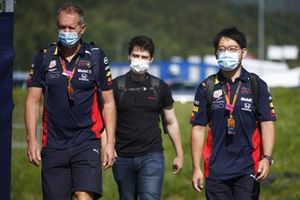 Members of the Red Bull Racing team arrive at the track