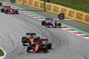 Charles Leclerc, Ferrari SF1000, leads Carlos Sainz Jr., McLaren MCL35, Lance Stroll, Racing Point RP20, and Sebastian Vettel, Ferrari SF1000