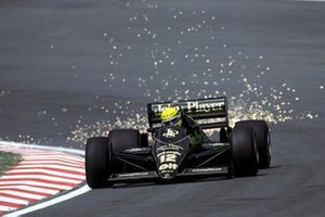 Ayrton Senna, Lotus 98T sends the sparks flying as he climbs Eau Rouge