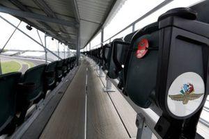 Signs designating proper social distancing on seats