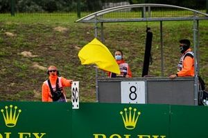 Marshal holds Safety Car board and yelow flag