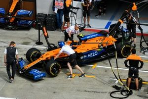 Car of Lando Norris, McLaren MCL35 being pushed by McLaren Mechanics