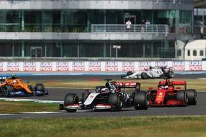 Romain Grosjean, Haas VF-20, Sebastian Vettel, Ferrari SF1000, and Lando Norris, McLaren MCL35