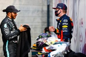 Lewis Hamilton, Mercedes AMG F1, talks with Max Verstappen, Red Bull Racing