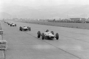 Dan Gurney, Brabham BT7 Climax, retired, leads John Surtees, Ferrari 158, and Lorenzo Bandini, Ferrari 156 Aero