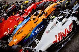 The cars of Kevin Magnussen, Haas VF-20, Carlos Sainz Jr., McLaren MCL35, Sebastian Vettel, Ferrari SF1000, in Parc Ferme after the race