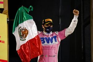 Sergio Perez, Racing Point, 1st position, on the podium with the Mexican flag