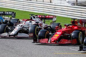 The cars of Kimi Raikkonen, Alfa Romeo Racing C41, and Charles Leclerc, Ferrari SF21