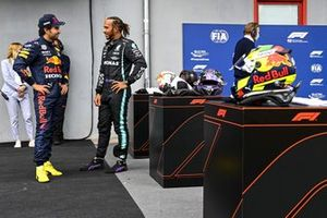 Sergio Perez, Red Bull Racing and Pole Sitter Lewis Hamilton, Mercedes in Parc Ferme