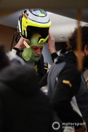 Jenson Button, JBXE Extreme-E Team, prepares in the garage