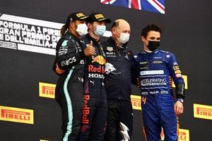 Lewis Hamilton, Mercedes, 2nd position, Max Verstappen, Red Bull Racing, 1st position, the Red Bull Racing representative, and Lando Norris, McLaren, 3rd position, on the podium