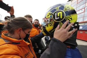 Lando Norris, McLaren MCL35M, 3rd position, celebrates with his team in Parc Ferme