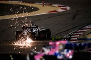 Sparks fly from Daniil Kvyat, AlphaTauri AT01