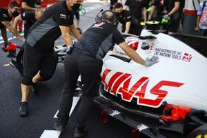 Kevin Magnussen, Haas VF-20, is returned to the garage