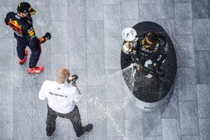 Max Verstappen, Red Bull Racing, Winning Constructor Representative and Race Winner Valtteri Bottas, Mercedes-AMG F1 celebrate on the podium with the champagne