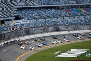 The pace car leads the field under the flag stand before the Wawa 250 at Daytona international Raceway