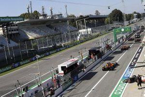 Lando Norris, McLaren MCL35, and Carlos Sainz Jr., McLaren MCL35, leave the pits