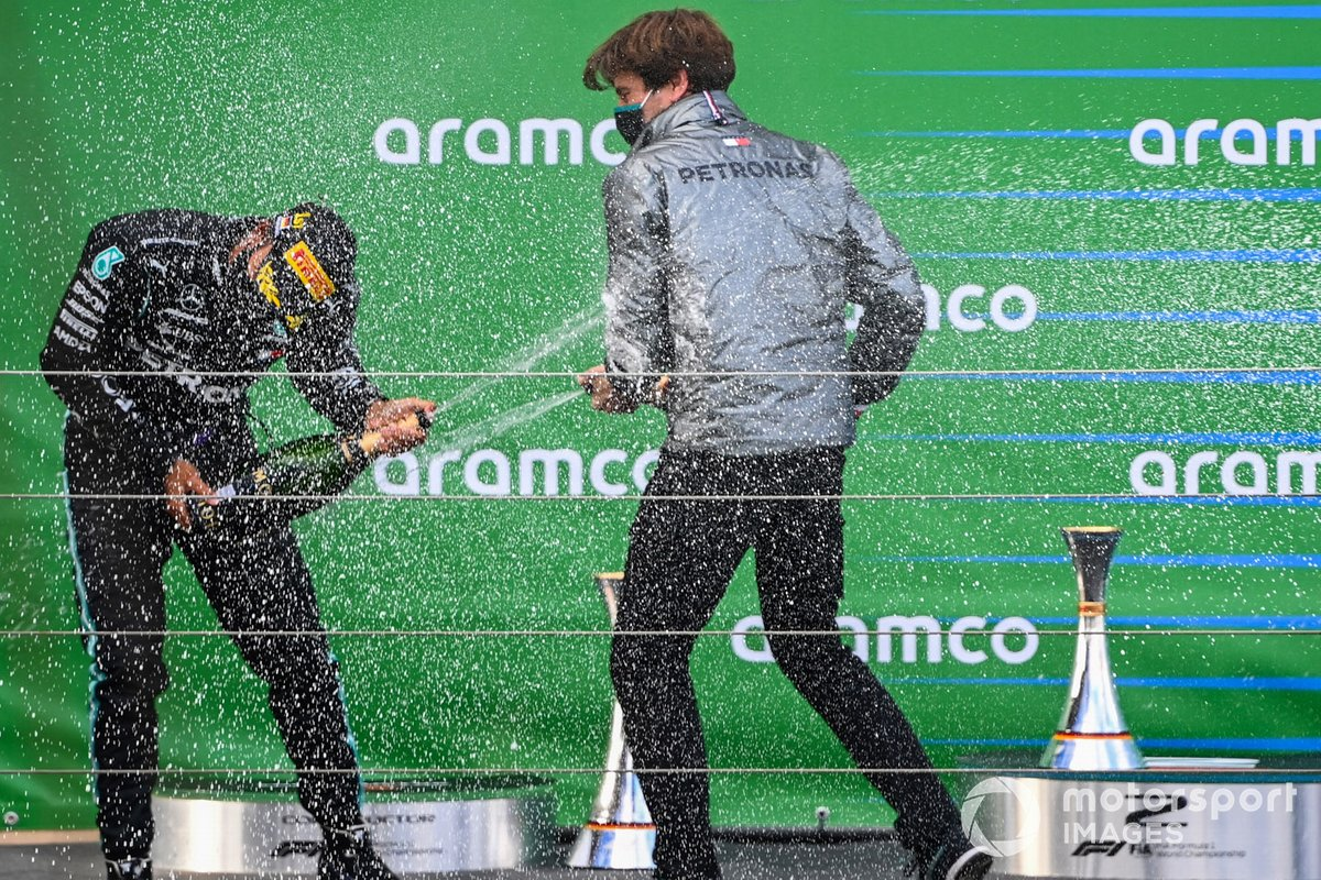 Lewis Hamilton, Mercedes-AMG F1, 1st position, and Steven Lord, Mercedes, ceebrate on the podium