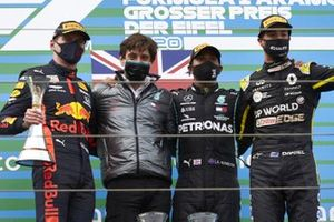 Max Verstappen, Red Bull Racing, 2nd position, Steven Lord, Mercedes, Lewis Hamilton, Mercedes-AMG F1, 1st position, and Daniel Ricciardo, Renault F1, 3rd position, on the podium