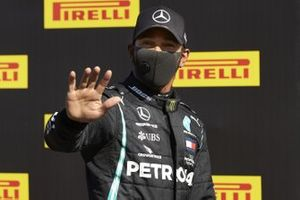 Lewis Hamilton, Mercedes-AMG F1, waves to the camera after securing pole