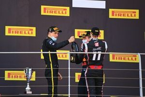 Winner Christian Lundgaard, ART Grand Prix celebrates on the podium with Louis Deletraz, Charouz Racing System and Juri Vips, Dams