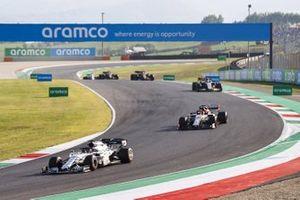 Daniil Kvyat, AlphaTauri AT01, Kimi Raikkonen, Alfa Romeo Racing C39, and Romain Grosjean, Haas VF-20