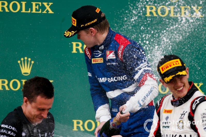 Robert Shwartzman, PREMA Racing and Leonardo Pulcini, Hitech Grand Prix celebrate on the podium with the champagne