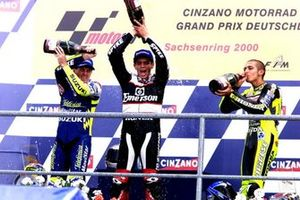Podium: Race winner Alex Barros, Pons Honda, second place Valentino Rossi, Honda, Kenny Roberts, Jr. Suzuki