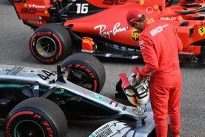 Sebastian Vettel, Ferrari, looks at the car of rival Lewis Hamilton, Mercedes AMG F1 W10, on the grid after Qualifying