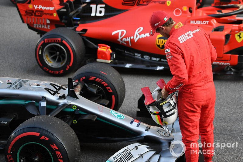 Sebastian Vettel, Ferrari, looks at the car of rival Lewis Hamilton, Mercedes AMG F1 W10, on the grid after Qualifying