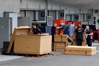 Red Bull Racing mechanics with freight