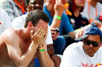 Fan with head in hands when Sebastian Vettel, Ferrari retires from qualifying