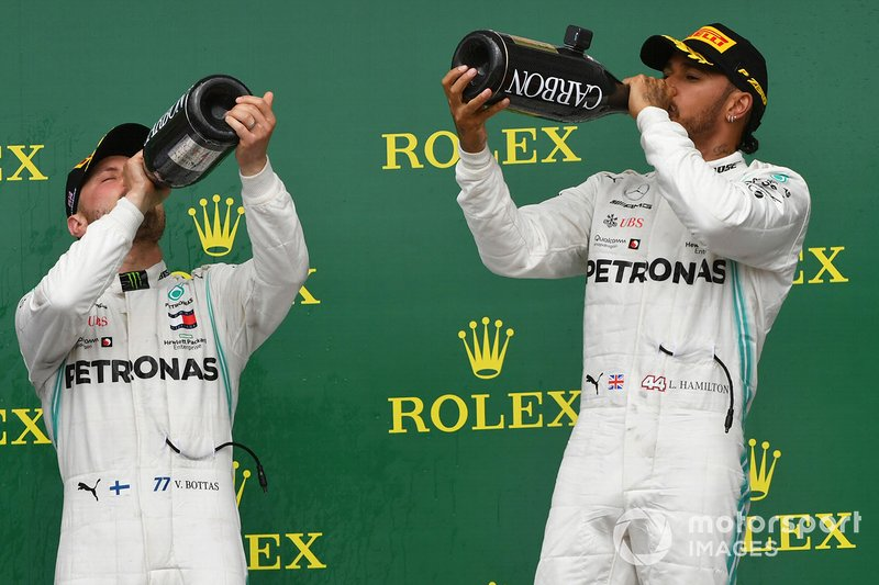 Valtteri Bottas, Mercedes AMG F1, 2nd position, and Lewis Hamilton, Mercedes AMG F1, 1st position, drink Champagne on the podium