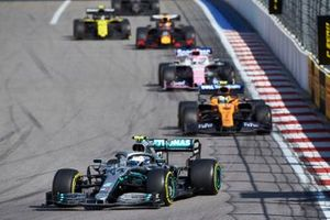 Valtteri Bottas, Mercedes AMG W10, leads Lando Norris, McLaren MCL34, Sergio Perez, Racing Point RP19, and Max Verstappen, Red Bull Racing RB15