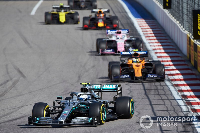 Valtteri Bottas, Mercedes AMG W10, leads Lando Norris, McLaren MCL34, Sergio Perez, Racing Point RP19, and Max Verstappen, Red Bull Racing RB15