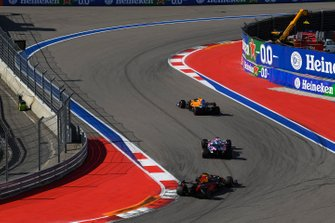 Lando Norris, McLaren MCL34, leads Sergio Perez, Racing Point RP19, and Max Verstappen, Red Bull Racing RB15