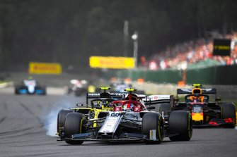 Antonio Giovinazzi, Alfa Romeo Racing C38, leads Nico Hulkenberg, Renault F1 Team R.S. 19, and Alex Albon, Red Bull RB15