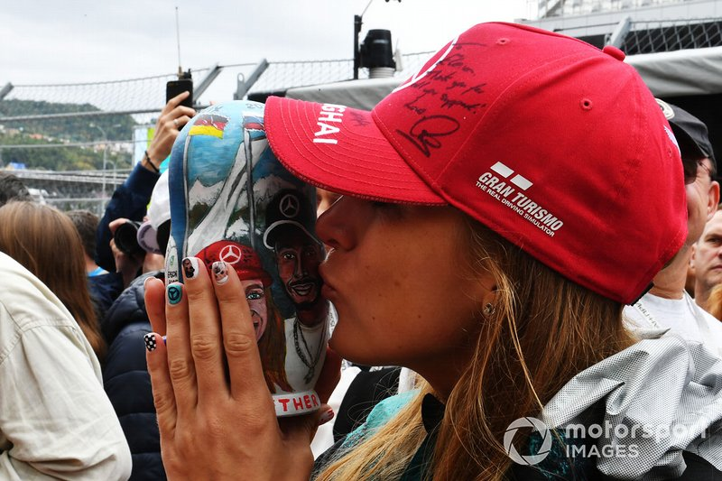 A fan of Lewis Hamilton in the pits