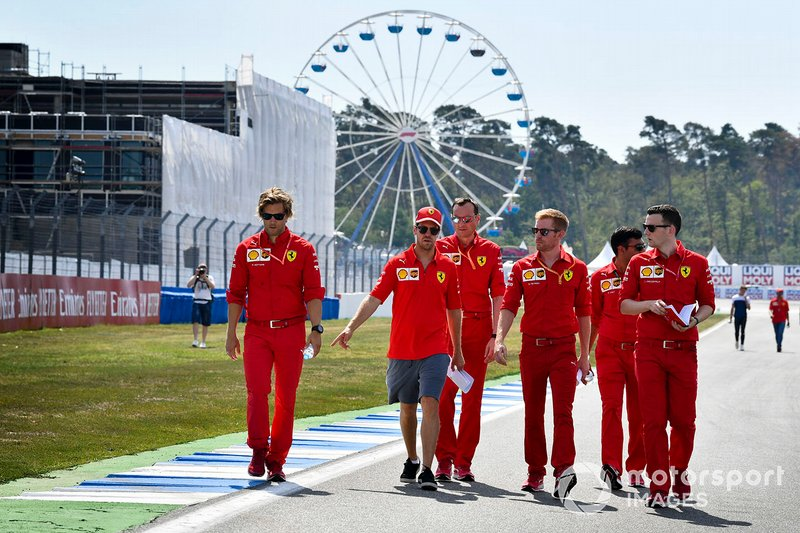 Sebastian Vettel, Ferrari walks the track with his mechanics