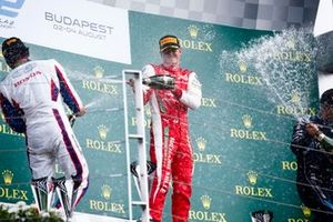 Nobuharu Matsushita, Carlin, Race winner Mick Schumacher, Prema Racing and Sergio Sette Camara, Dams celebrate on the podium with the champagne