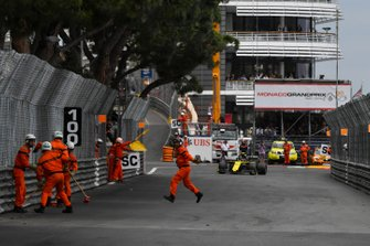 Marshals clear the track as Nico Hulkenberg, Renault R.S. 19, approaches