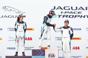 Ahmed Bin Khanen, Saudi Racing, 1st position, Célia Martin, Viessman Jaguar eTROPHY Team Germany, 2nd position, Yaqi Zhang, Team China, 3rd position, on the podium, Bin Khanen, Zhang shake hands