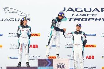 Ahmed Bin Khanen, Saudi Racing, 1st position, Célia Martin, Viessman Jaguar eTROPHY Team Germany, 2nd position, Yaqi Zhang, Team China, 3rd position, on the podium, Bin Khanen, Zhang shake hands