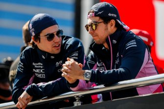 Lance Stroll, Racing Point, and Sergio Perez, Racing Point, talk in the drivers parade