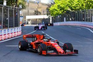 Sebastian Vettel, Ferrari SF90, leads Sergio Perez, Racing Point RP19, and Max Verstappen, Red Bull Racing RB15
