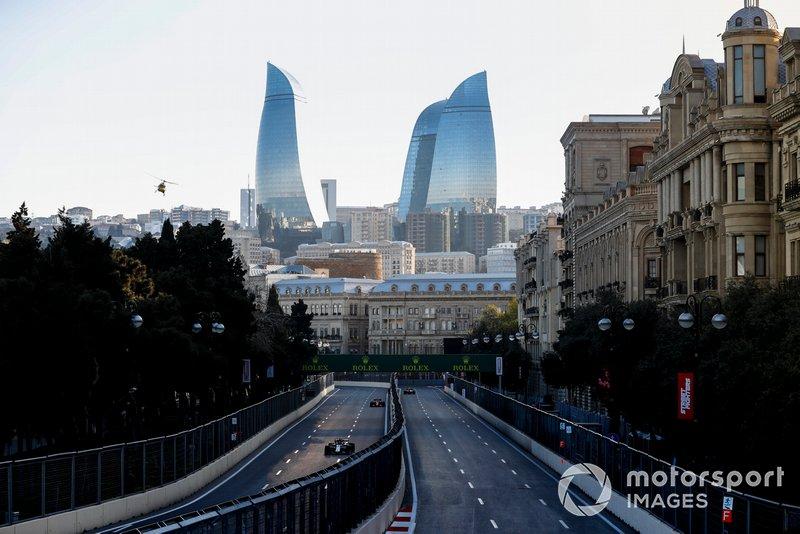 Kimi Raikkonen, Alfa Romeo Racing C38, devant Sebastian Vettel, Ferrari SF90